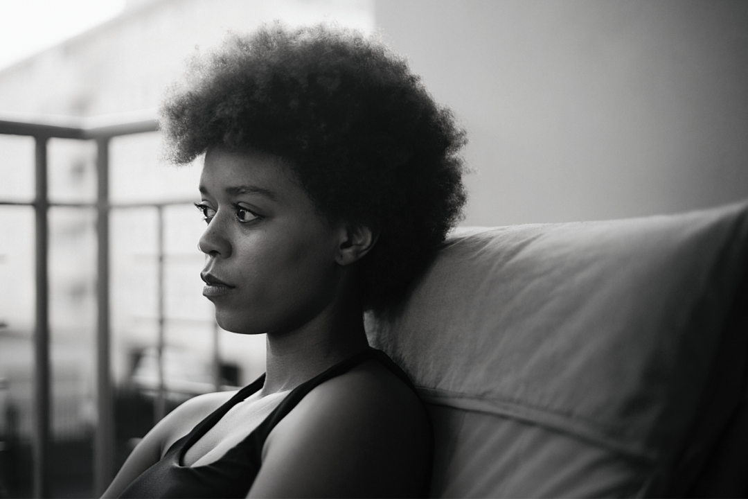 Black Girl with Afro Sitting on a Chair